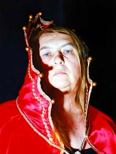 Photo of Tina Rath in red gothic cloak